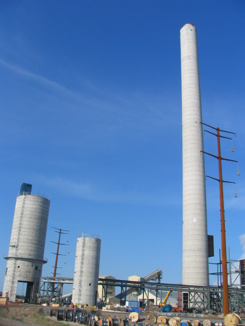 Two silos and concrete chimney designed and built by Commonwealth at the same site.